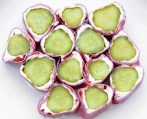 an easy almost no carb snack on the go is wrapping up a pickle with cream cheese and meat