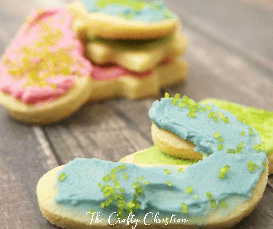 keto christmas sugar cookies in pink and blue on a wood background