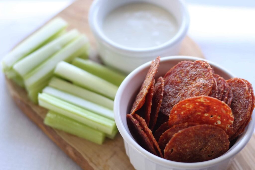 on the go keto snacks like microwave pepperoni chips with celery and dip