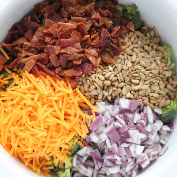 keto broccoli salad recipe with ingredients in a bowl before mixing
