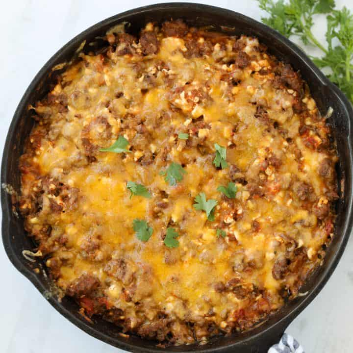 taco casserole keto in a skillet on a white background
