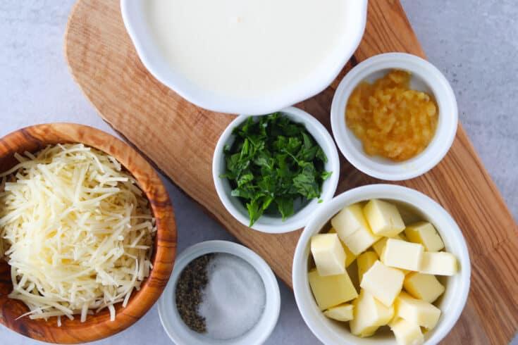 keto alfredo sauce ingredients on a cutting board