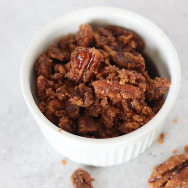 keto candied pecans in a white ramekin after cooking