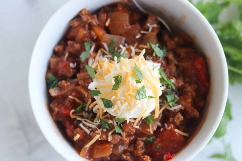 low carb chili recipe in a bowl top down view