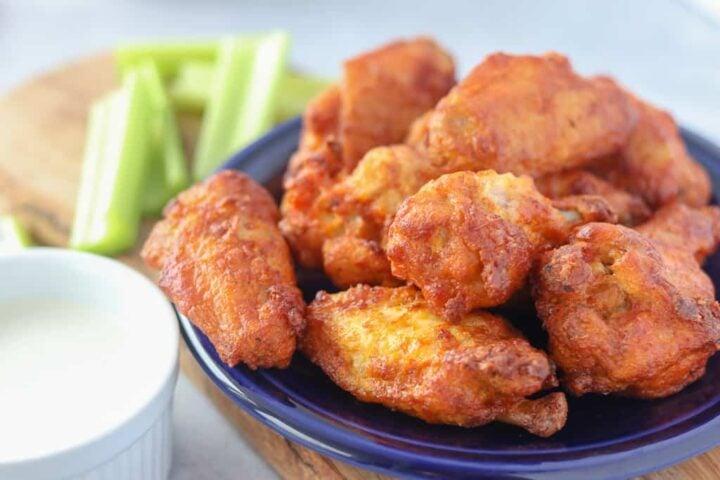 air fryer frozen chicken wings on a blue plate