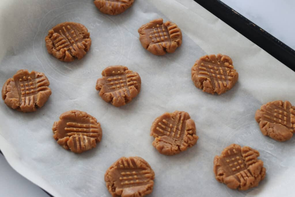 press the 3 ingredient peanut butter cookies with a fork to flatten