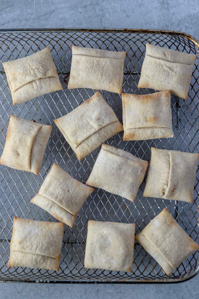 frozen air fryer pizza rolls before cooking on a oven style tray