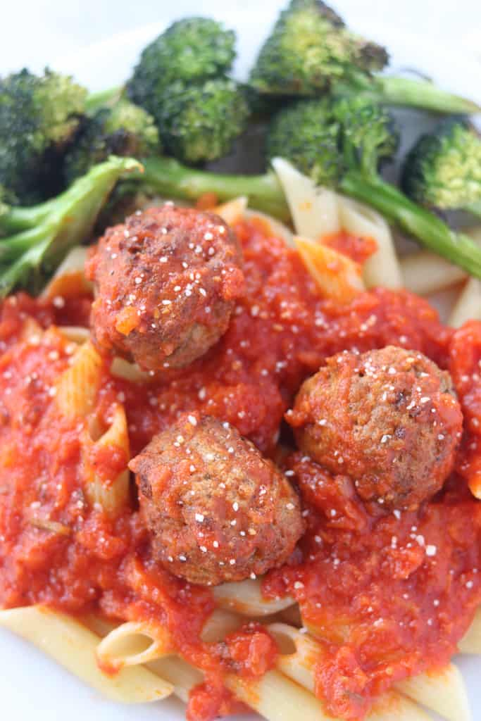 air fryer frozen meatballs with pasta, sauce, and broccoli on a plate