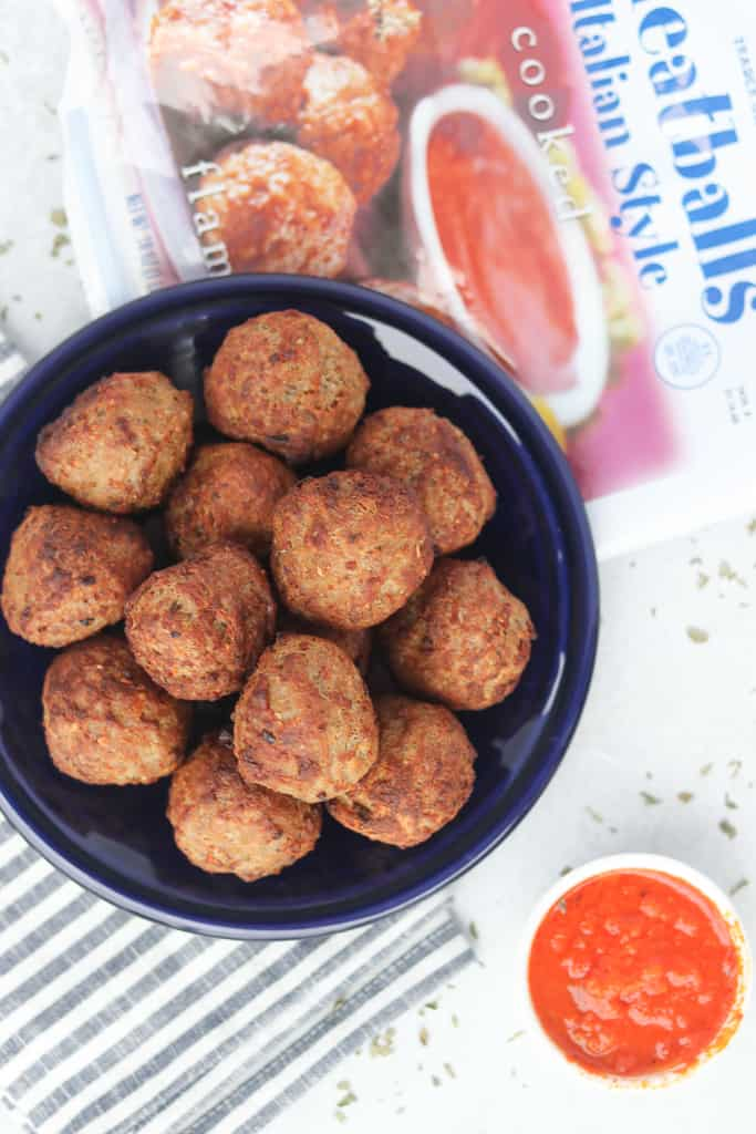 frozen-meatballs-air-fryer recipe after cooking with marinara and the package