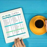 air fry cook times pdf on ipad with cup of coffee