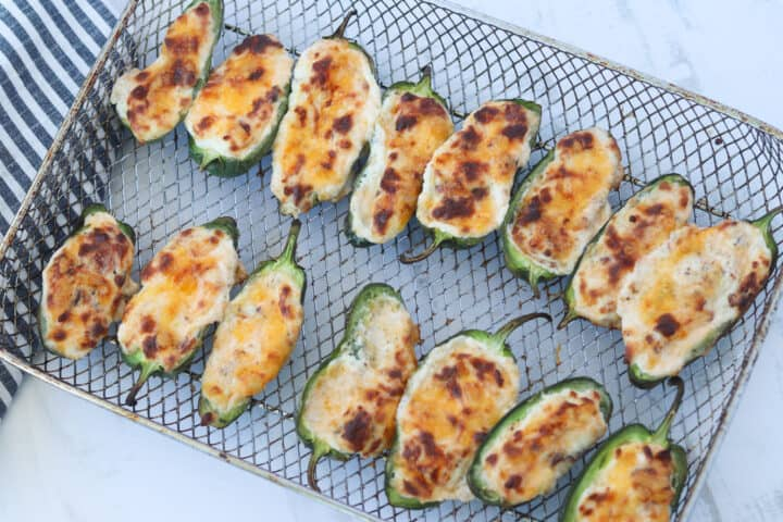 air fryer jalapeno poppers on the baking pan after cooking