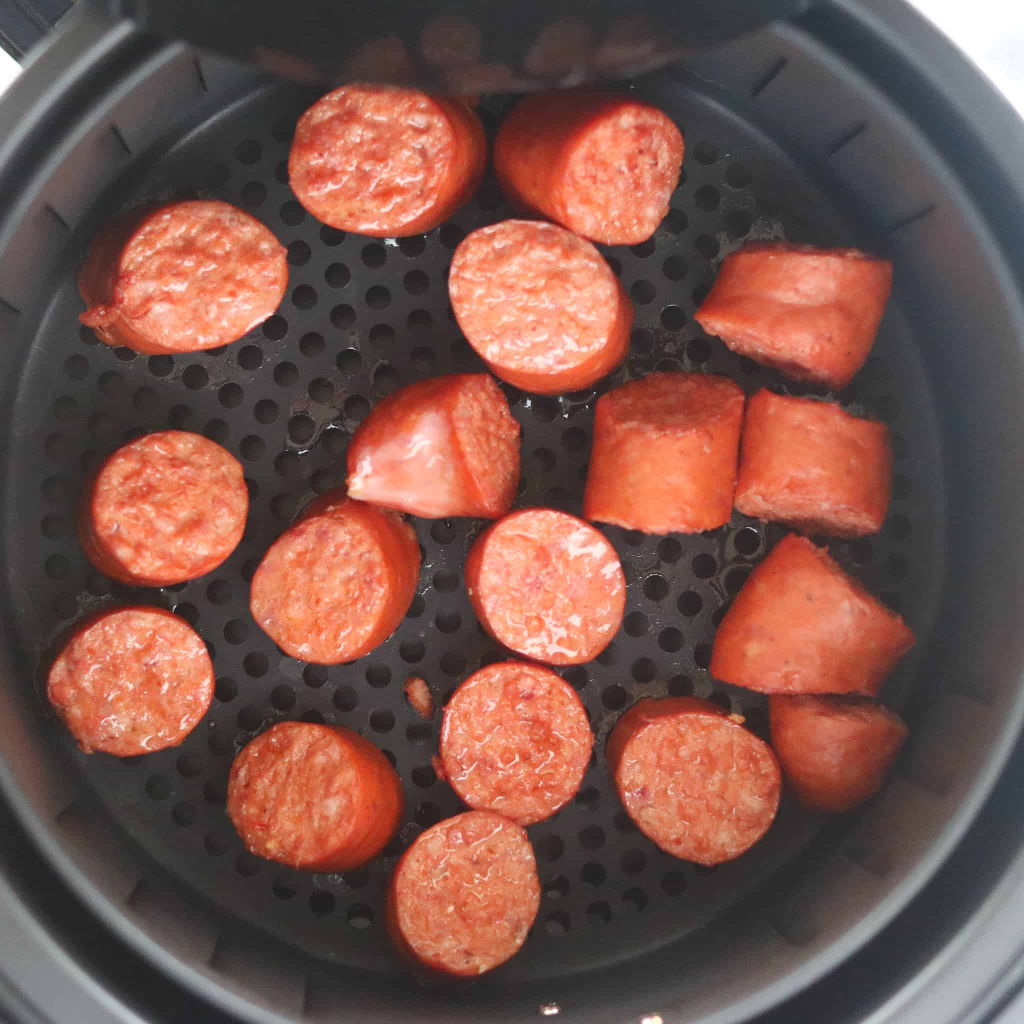 air fryer kielbasa cooked in the pot looking down view