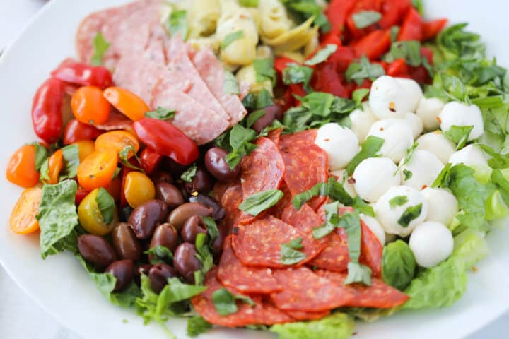 antipasto salad keto in a bowl before drizzling the dressing