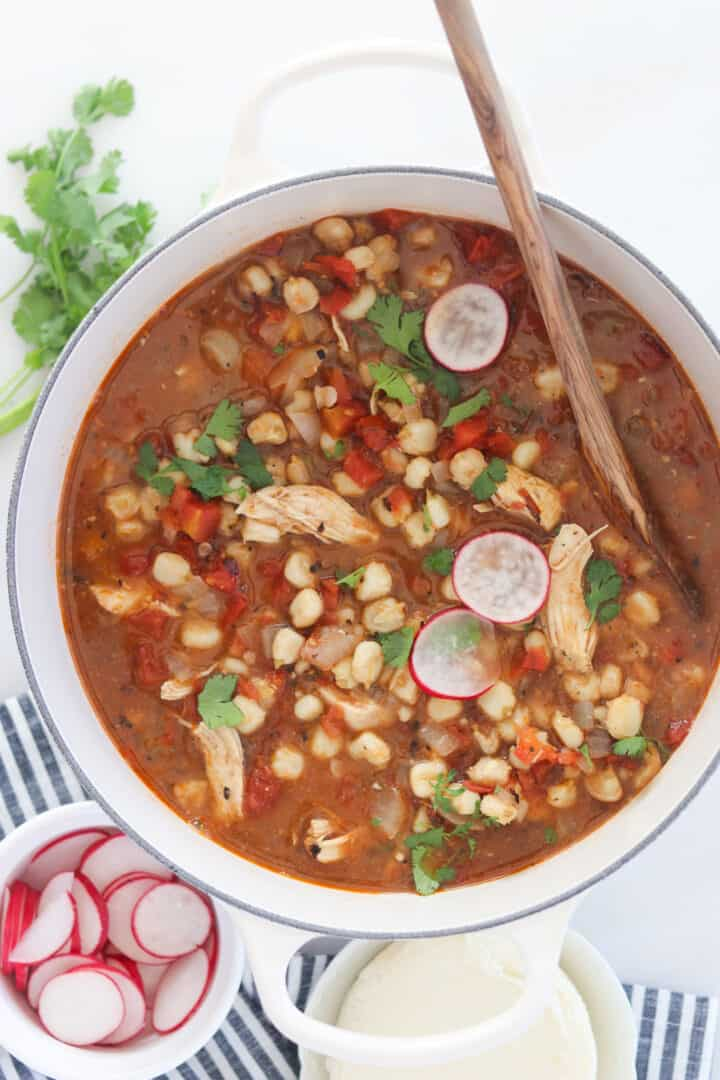 a pot of chicken pozole soup in a dutch oven