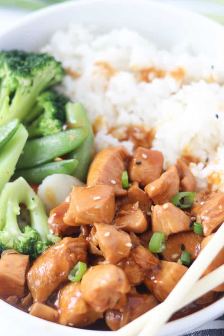 chicken teriyaki bowls with rice and chopsticks