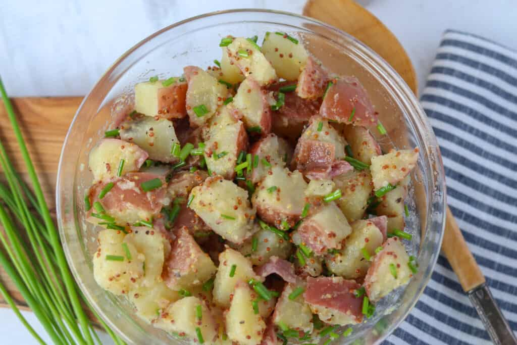 german mustard potato salad in a bowl