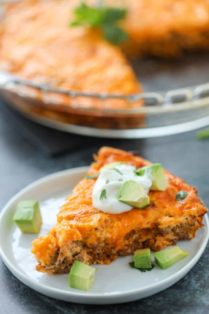 the keto taco pie on a white plate after serving