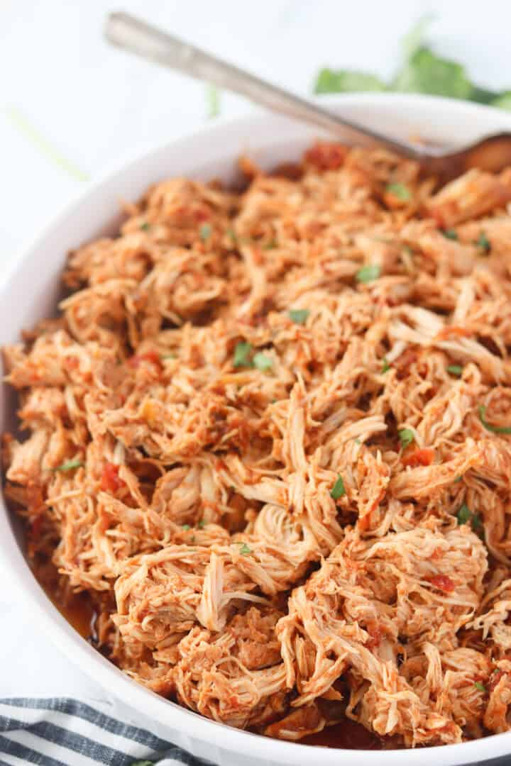 mexican shredded chicken slow cooker in a bowl ready to serve