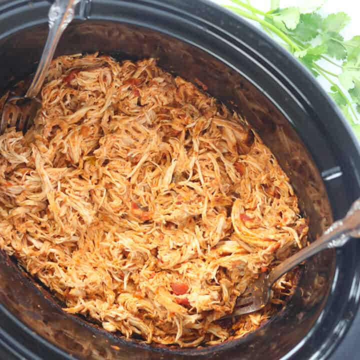 slow cooker mexican shredded chicken in a crockpot after getting shredded