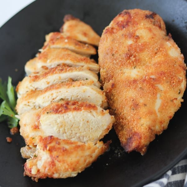 air fryer breaded chicken breast on a plate after cooking
