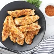 air fryer chicken tenders no breading on a plate and cooked
