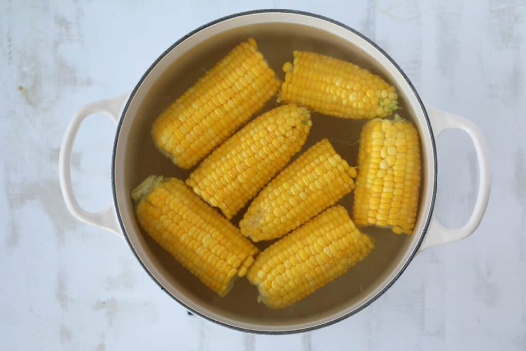 doing a corn on the cob boil can be with just water. Showing corn about to get cooked in a pot.