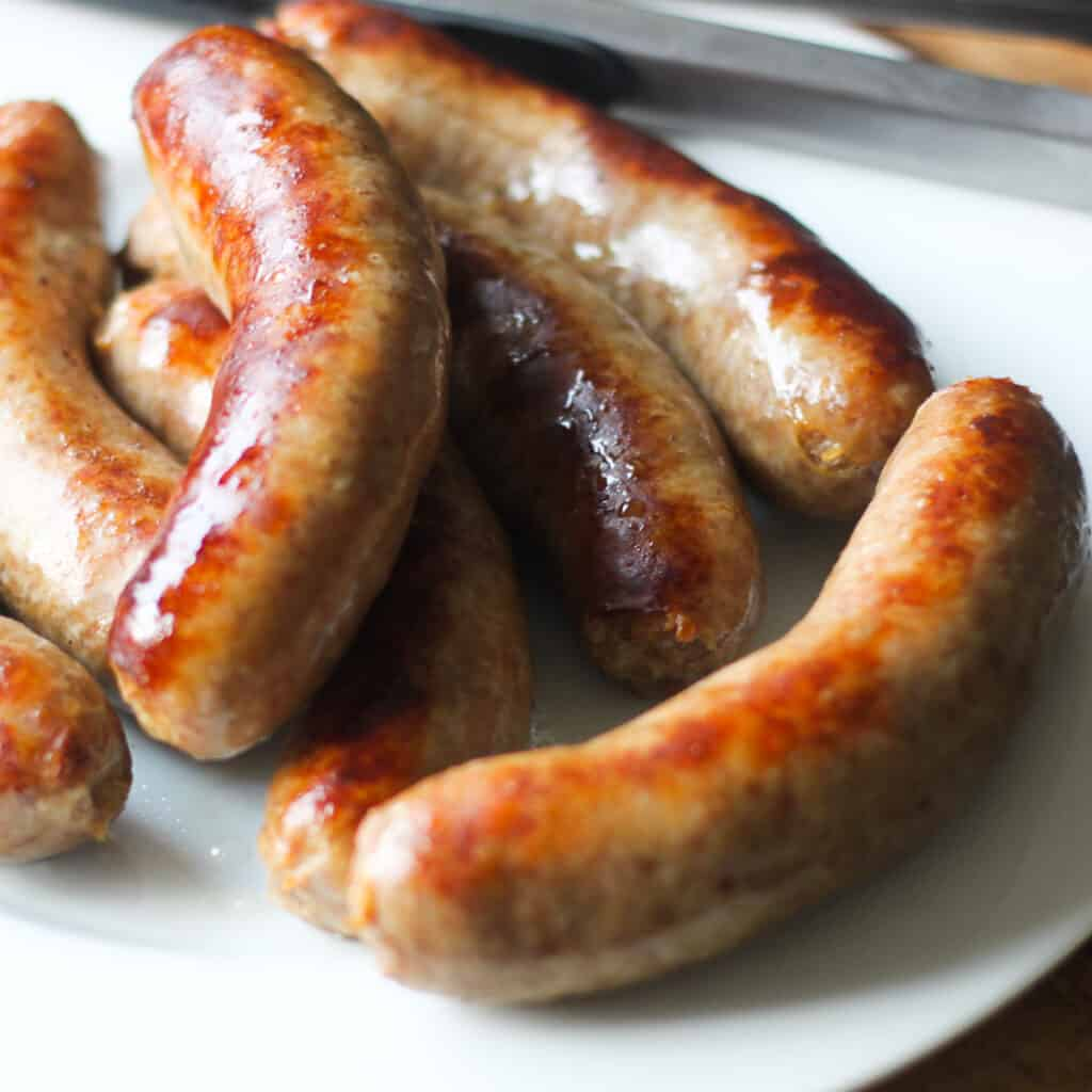 how to cook bratwurst with a plate of cooked brats golden brown