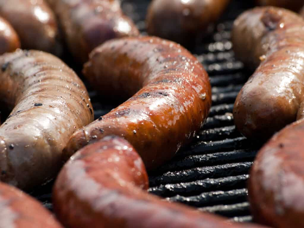 how to grill brats photo on them cooking on a bbq