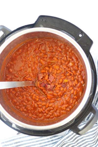 instant pot baked beans in a pressure cooker with spoon