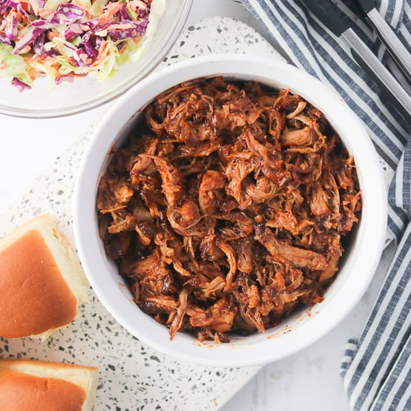 instant pot pulled pork recipe in a bowl and ready to serve