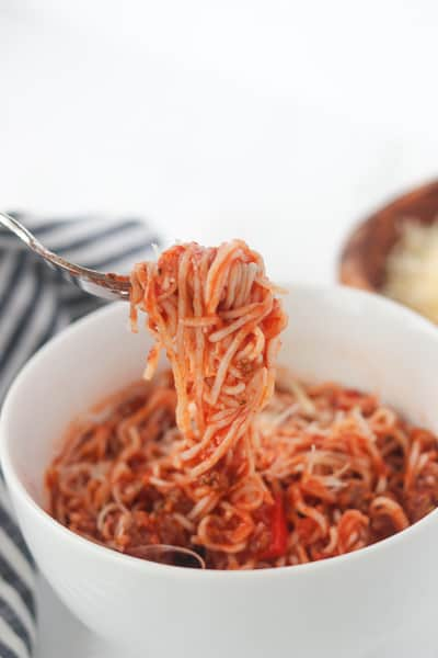 keto spaghetti sauce in a bowl with keto spaghetti noodles wrapped around a fork