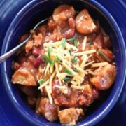 kielbasa chili in a blue bowl square image looking down