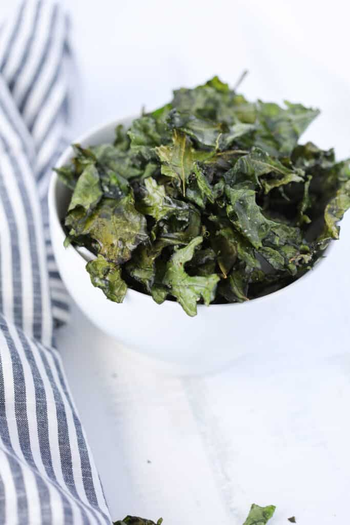 kale chips air fryer recipe served in a white bowl on a white background