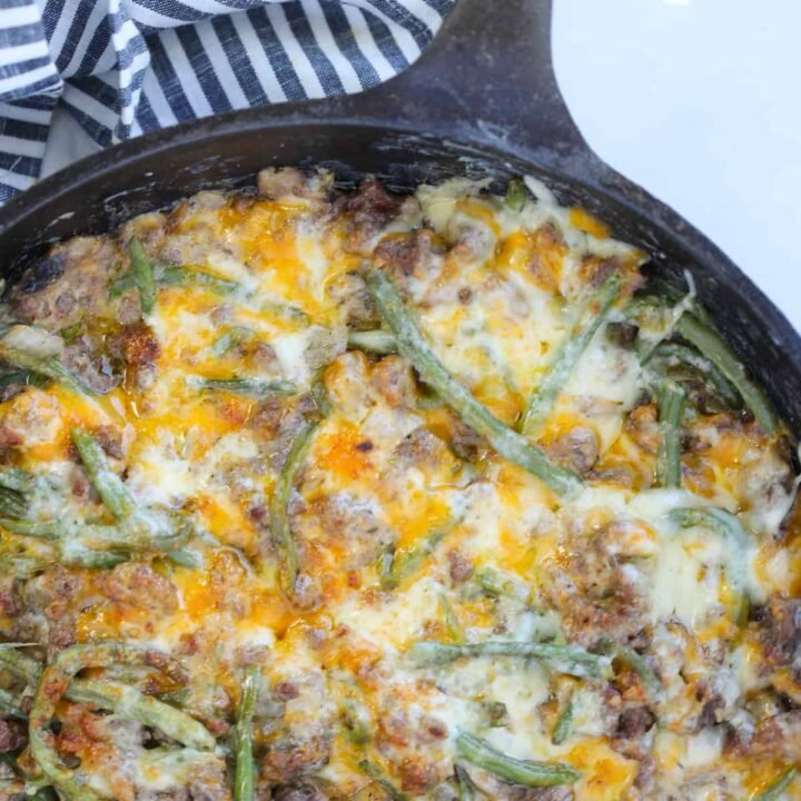 hamburger green bean casserole in a cast iron skillet after cooking