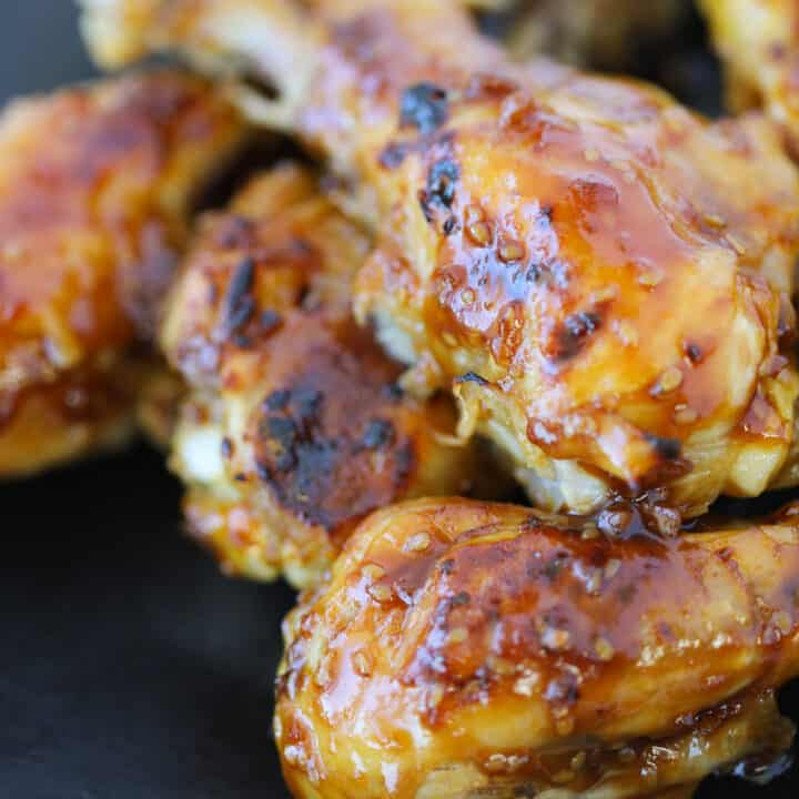 close up of instant pot chicken legs after broiling