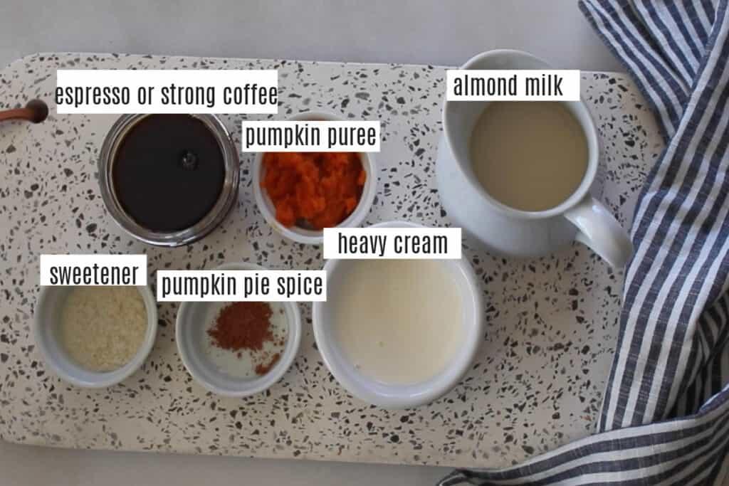 keto pumpkin spice latte recipe ingredients on a cutting board