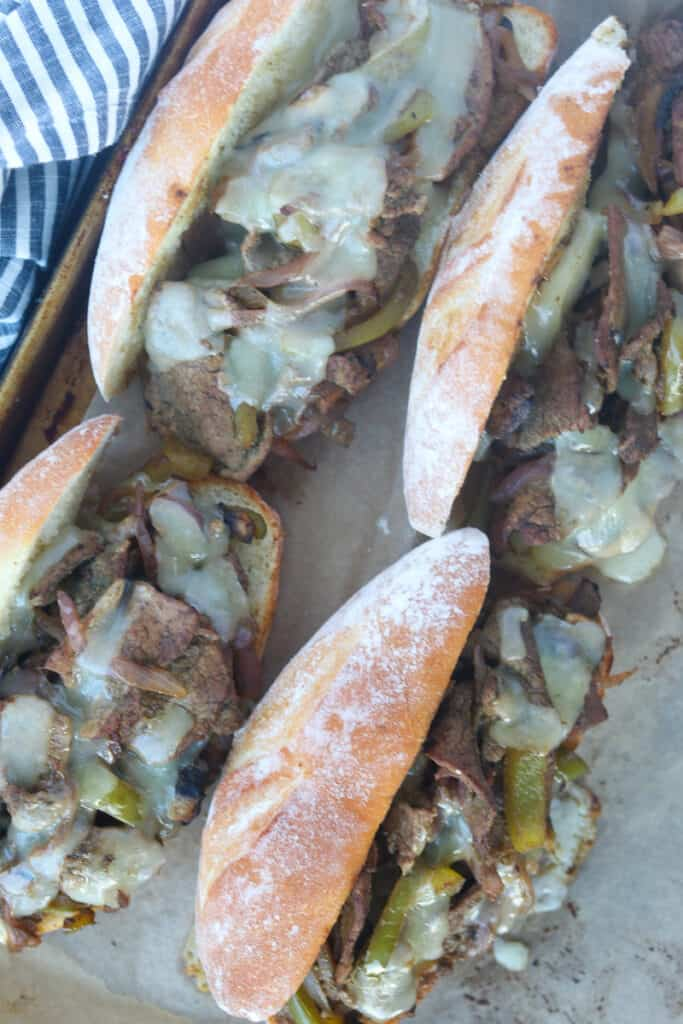 the Philadelphia cheesesteak recipe on a baking sheet after melting the provolone cheese