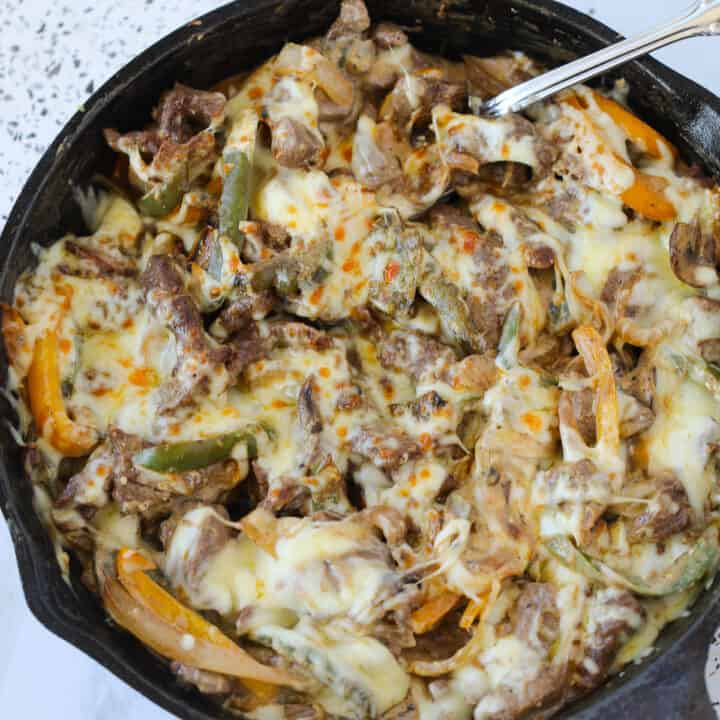 philly cheese steak casserole square with a spoon in the pan