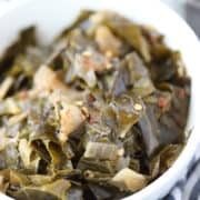 vegan collard greens recipe closeup image with hot sauce