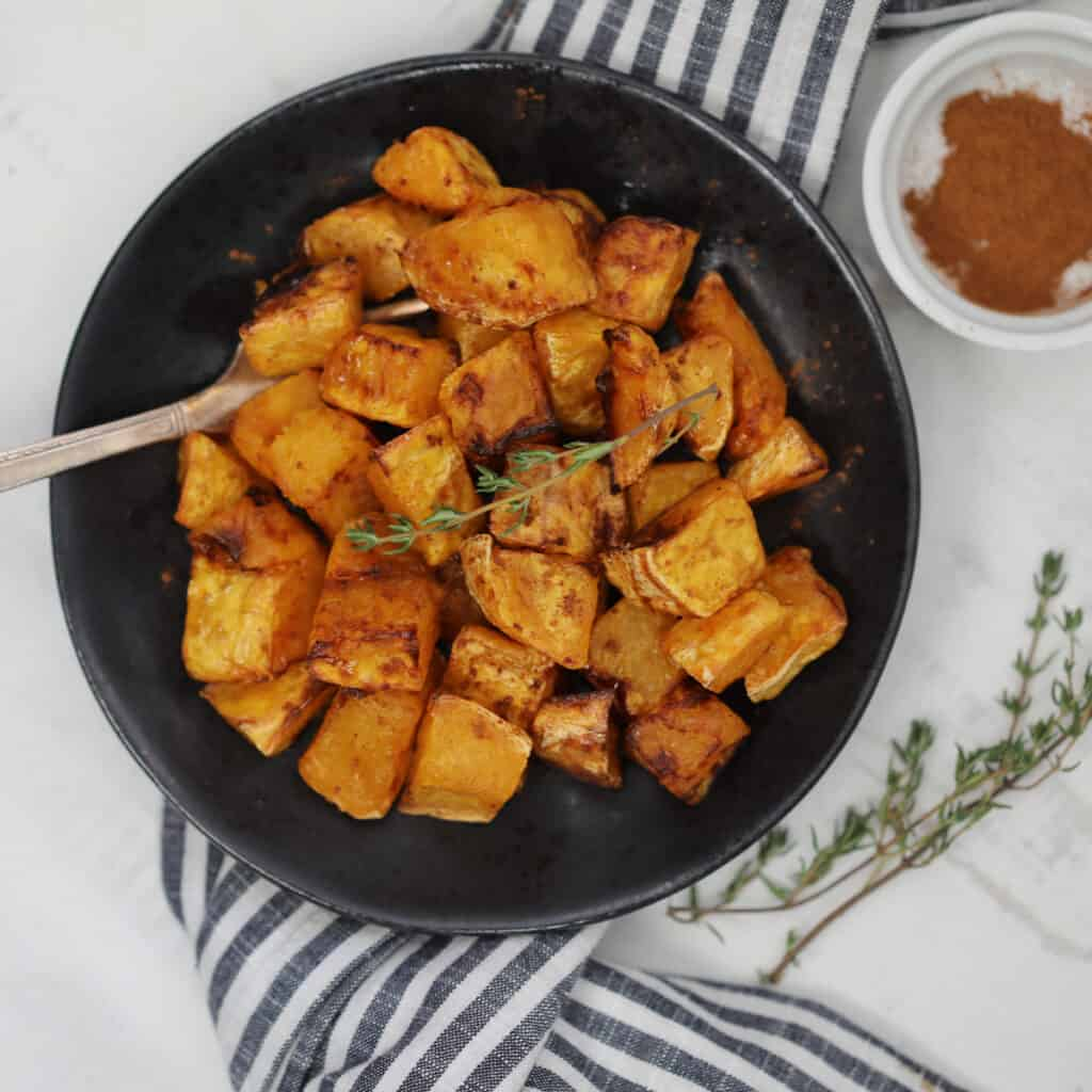 air fryer butternut squash with maple syrup and cinnamon ready to serve