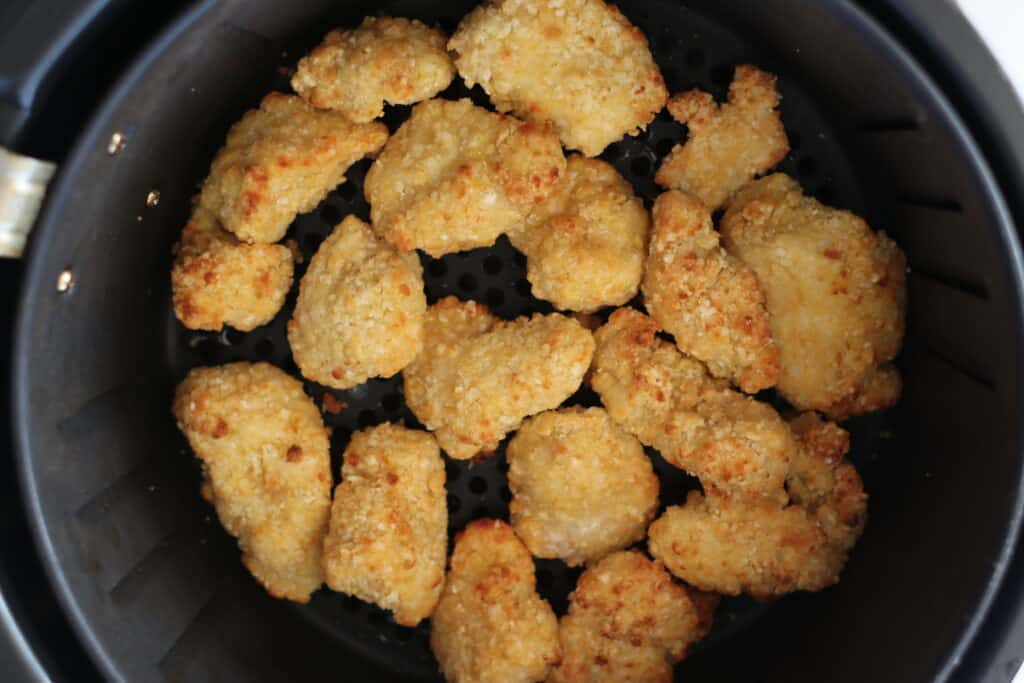 air fryer chicken nuggets frozen and now cooked in the basket before serving