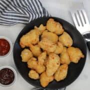 air fryer frozen chicken nuggets next to BBQ sauce