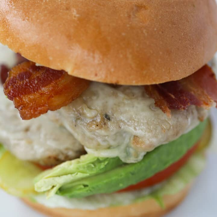 air fryer turkey burgers with lettuce, avocado, bacon, and swiss cheese