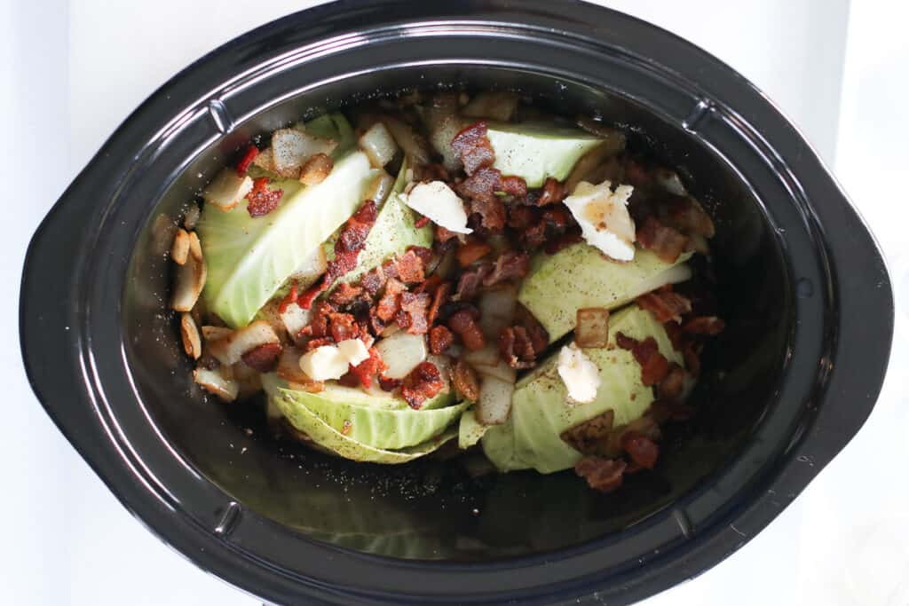 the cabbage in slow cooker image before cooking