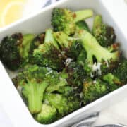 the frozen broccoli air fryer recipe in a white dish on a white background