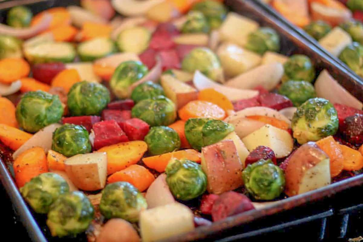 spread the roasted fall veggies between two pans