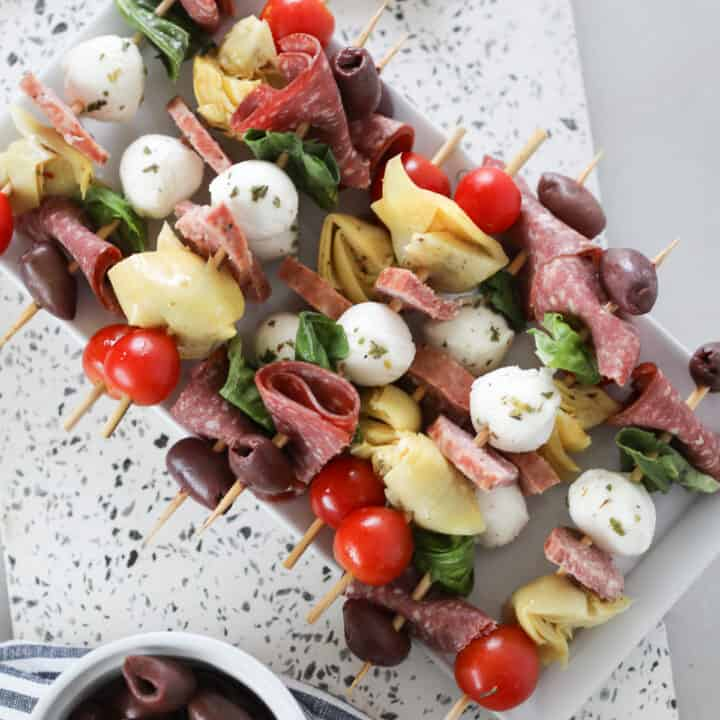 antipasto skewers recipe looking down on a white platter