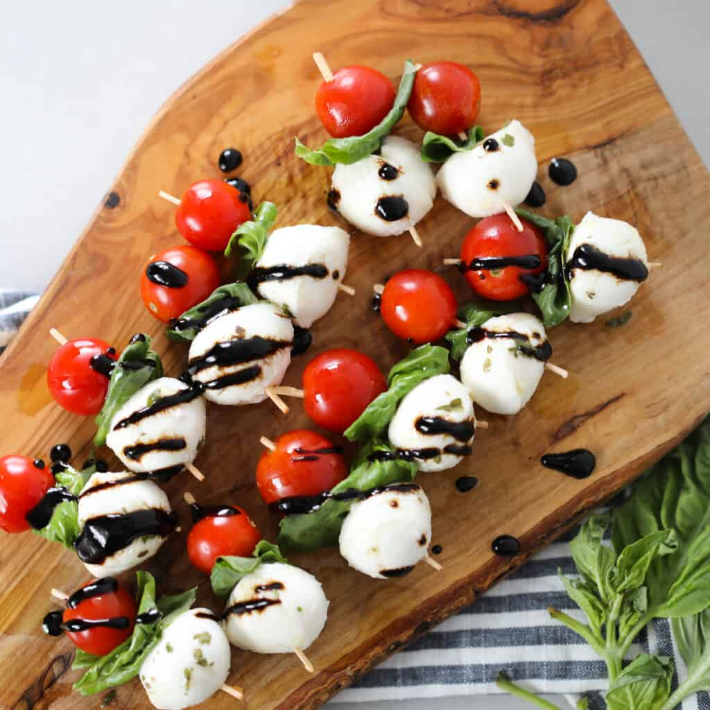 caprese salad skewers on a cutting board