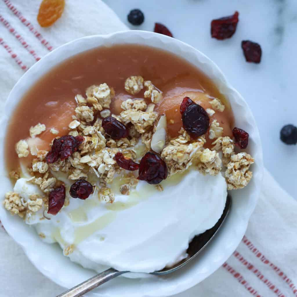 instant pot apple sauce in a bowl with yogurt and granola