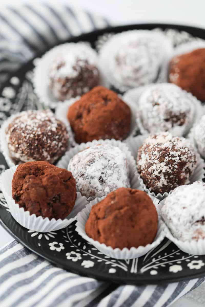 keto candy recipes like low carb rum balls covered with coconut in a white wrapper